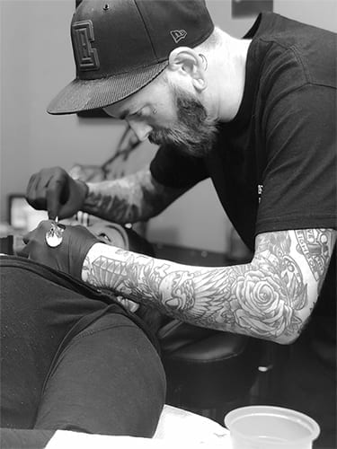 Topher, Piercer, Revolt Tattoos